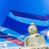 Giant Budda Statue in Phuket. Composite image. Giant Budda Statue in Phuket, Thailand set against transparent background of Thai national flag Stock Image