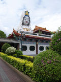 Giant Buddha. A giant Kwan Yin Buddha sit on the roof top which found in Kek Lok Si Temple, Penang Island Malaysia Royalty Free Stock Photo