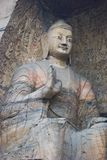 Giant Buddha in cave. Buddha cave in China. The statue is giant standing very high Stock Photos