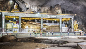 Giant buddha in a cave Stock Photo