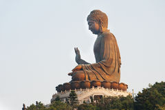 The giant Buddha glowing in the sun royalty free stock photos
