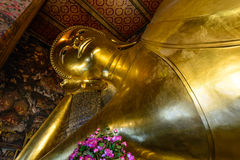 Giant Buddha inside Wat Pho Temple, Bangkok in Thailand Stock Photos