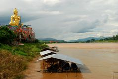 Giant Buddha near Mekong river at Golden Triangle. Sop Ruak, Thailand Stock Photos