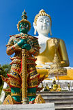 Giant and Buddha statue Stock Photo