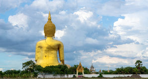 A giant Buddha statue looks out over downtown Thailand at sunset from Bongeunsa Temple. Royalty Free Stock Image