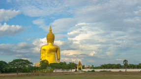 A giant Buddha statue looks out over downtown Thailand at sunset from Bongeunsa Temple. Stock Image