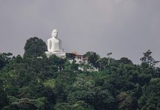 Giant Buddha statue on the mountain royalty free stock image