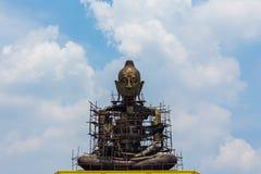 Giant Buddha - Stock Image. Giant Buddha sitting with blue sky background Stock Photo