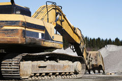Bulldozers and trucks in action Stock Images