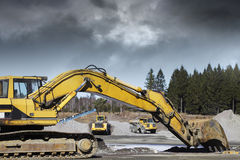 Bulldozers and trucks in action Royalty Free Stock Images