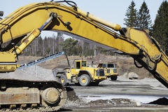 Bulldozers and trucks in action Royalty Free Stock Photography