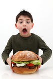 Giant Burger. Super huge giant burger and a hungry boy stock images