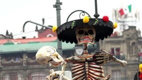 A giant cardboard skeleton puppet is shown