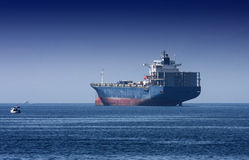 Giant cargo ship on the sea. Giant cargo ship anchoring  in the commercial harbor of Antalya, Turkey Stock Images