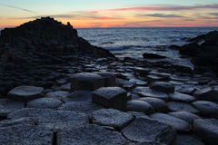 Giant Causeway In Antrim County At Sunset Stock Images