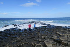 Giant causeway in north ireland. The Giant's Causeway is an area of about 40, 000 interlocking basalt columns, the result of an ancient volcanic eruption. It is royalty free stock images