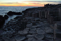 Giant  Causeway in Northern Ireland at sunset Stock Images