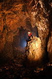 Giant cave hall. With a spelunker Stock Photo