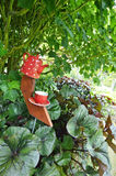 Giant ceramic teapot, cup and saucer garden ornament sculpture stock photography