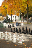Giant checkers game in a park in Geneva, Swiss. Giant chess game ready to play in a park during fall season royalty free stock image