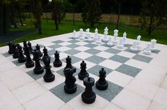 Giant chess board in a beautiful park in Italy royalty free stock photography