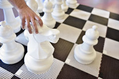Giant chess game with knight move Royalty Free Stock Photography