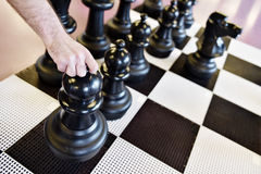 Giant chess game with pawn move Stock Images