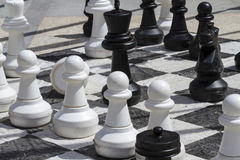 Giant chess games in the street with large pieces Royalty Free Stock Image