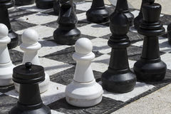 Giant chess games in the street with large pieces Royalty Free Stock Photos
