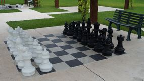 Giant Chess Set at A Pubic Resort. This is a Giant Chess Set that is positioned near a concrete walking path stock photo