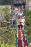 A giant Chinese dragon artwork. Entrance from the giant Chinese dragon in Thailand Stock Photography