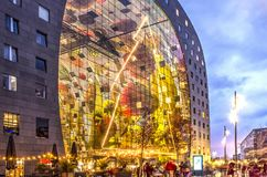 Markthal at Christmas. Giant Christmas tree decorating the glass facade of the Markthal / market hall at dusk royalty free stock photo