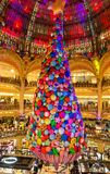 The giant Christmas tree inside Galeries Lafayette Parisian department store,Paris, France. Paris France-13 December 2017: Giant Christmas tree inside Galeries Stock Photo