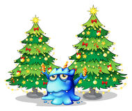 Giant christmas trees at the back of the blue monster vector illustration