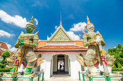 Giant at churches temple of dawn, Bankok Thailand. Blue sky Royalty Free Stock Images
