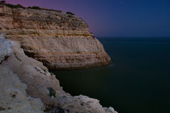 Giant cliff towards the sea Stock Photos