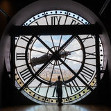 The giant clock of the Musee dOrsay in Paris. Paris, France - October 19, 2016: giant clock of Musee dOrsay with unidentified people. It houses in the former Royalty Free Stock Image