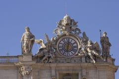 Giant clock on Saint Peter Basilica rooftop. ROME, ITALY - DECEMBER 31 2014: Giant clock on Saint Peter Basilica rooftop in Rome, Italy stock photos