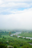 Giant cloud. Bridge over river. Foggy weather. Royalty Free Stock Images