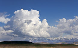 A giant cloud over the mountains of the Great Caucasus. Royalty Free Stock Images