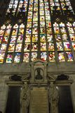 Giant colorful window of Milano Duomo Cathedral. MILAN, ITALY - MAY 11 2015: Giant colorful window of Milano Duomo Cathedral with apostolic depictions Royalty Free Stock Photography