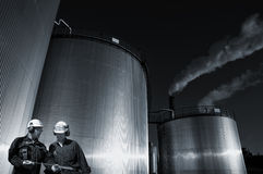 Giant commercial storage tanks and workers Stock Images