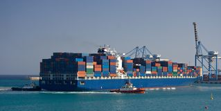 Docking Container Ship, Malta. A giant container ship in the harbor of Birzebbuga, Malta Royalty Free Stock Photography