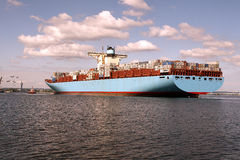 Among giant container ships. Edith Maersk is one of the three largest container ships in the world. The length of the ship is 398m and width of 56 m, on board Royalty Free Stock Photo