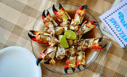 Giant crab claws in a dish. Restaurant table Royalty Free Stock Images
