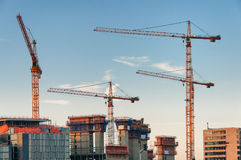 Giant cranes on a construction site. Four giant cranes on a construction site in Amsterdam, Netherlands Royalty Free Stock Image