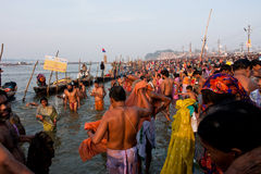 Giant crowd of hindus in the river. Crowd of indian people come to the confluence of the Ganges and the Yamuna during the biggest gathering on Earth, festival Stock Photo