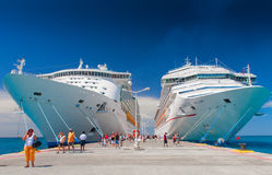 Giant cruise ships Carnival Valor and Mariner of the Seas are docked together. Over 7,000 passengers are visiting the Island. PHILIPSBURG, SAINT MARTIN - 10:00 Royalty Free Stock Photos