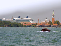 Giant cuise ship passing by the islands of Venice lagoon Royalty Free Stock Photography