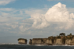 Giant cumulus clouds above cliffs at Cape Foulwind Royalty Free Stock Image